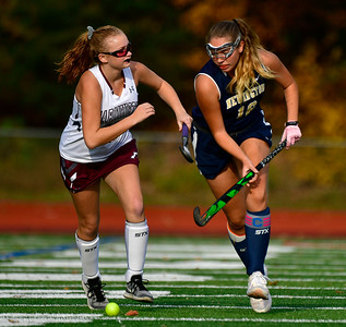 11/1/2018 Mike Orazzi | Staff Farmington's Ashley White (20) and Newington's  Maya Gajowiak (16) during field hockey at Farmington High School Thursday.