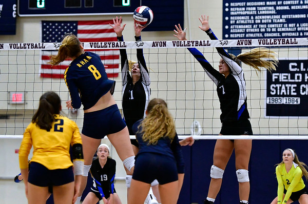 11/1/2018 Mike Orazzi   Staff Bristol Eastern's Ryley Plourde (11) and Zoe Lowe (7) and RHAM's Kaylin Hadley (8) during the CCC Volleyball Tournament at Avon High School Thursday night.
