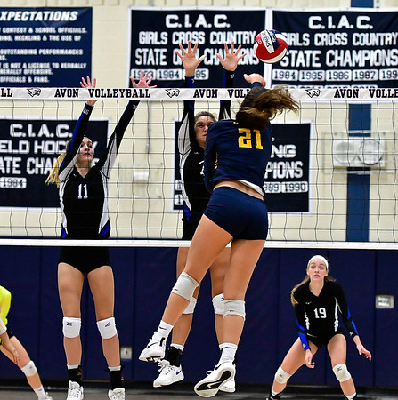 11/1/2018 Mike Orazzi   Staff Bristol Eastern's Ryley Plourde (11) and Zoe Lowe (7) and RHAM's Bella Johnson (21) during the CCC Volleyball Tournament at Avon High School Thursday night.