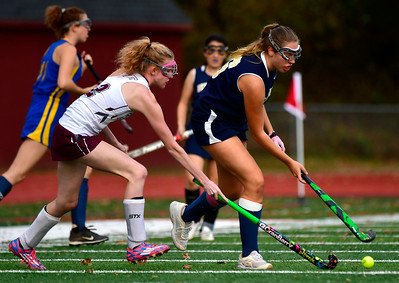 11/1/2018 Mike Orazzi | Staff Farmington's Olivia Burt (2) and Newington's  Maya Gajowiak (16) during field hockey at Farmington High School Thursday.