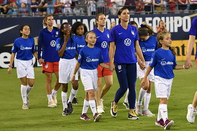 While she didn't play in the match in Charlotte, Alex Morgan walked in with the team and their youth partners.