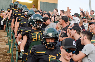 The Paradise football team walks down the stadium steps to a roaring crowd before their first post-Camp Fire home game on Aug. 23 in Paradise. (Matt Bates -- Enterprise-Record)