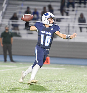 Pleasant Valley's Ian Guanzon looks to fire a pass against Red Bluff on Sept. 27, at Asgard Yard. (Matt Bates -- Enterprise-Record File)