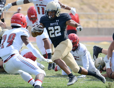 Butte's Avery McCuaig (22) weaves through traffic agaisnt City College of San Francisco on Sept. 22, 2018, at Cowan Stadium in Butte Valley. (Bill Husa -- Enterprise-Record file)