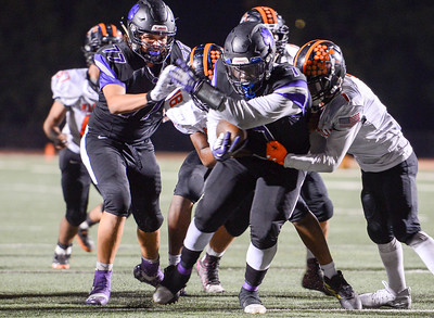 Oroville running back Kacie Riley attempts to break through a tackle during the Tigers' game against Marysville on Sept. 6 in Oroville. (Matt Bates -- Enterprise-Record)