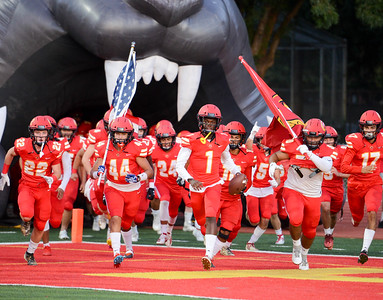 Chico High's football team bursts on to the field for their home opener against Yuba City on Sept. 13 in Chico. (Matt Bates -- Enterprise-Record)