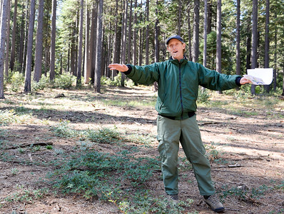 Jason Miller, fuels battalion chief for the Feather River Ranger District, speaks about forest managment techniques during the Berry Creek forest health tour Tuesday in Berry Creek. (Matt Bates -- Enterprise-Record)