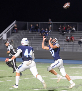 Pleasant Valley's Brett Williams attempts to haul in a pass as Austin York watches during the Vikings' game against Rancho Cotate on Sept. 20 in Chico. (Matt Bates -- Enterprise-Record)