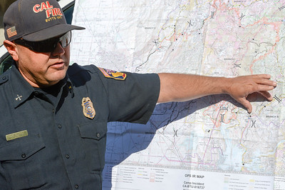 Cal Fire-Butte County Battalion Chief Gus Boston goes over a Camp Fire map during the Berry Creek forest health tour Tuesday in Berry Creek. (Matt Bates -- Enterprise-Record)