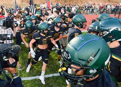 The Paradise football team runs onto the field before their first post-Camp Fire home game on Aug. 23 in Paradise. (Matt Bates -- Enterprise-Record)
