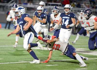 Pleasant Valley's Junior Rivera tries to break free from Rancho Cotate's Dylan Barella during the Vikings' game against the Cougars on Sept. 20 in Chico. (Matt Bates -- Enterprise-Record)