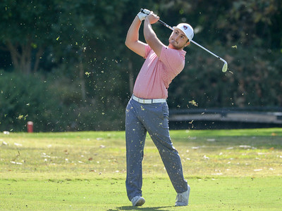 Nicholas Caputo hits an iron off the fairway during the final round of the Wildcat Invitational at Butte Creek Country Club on Tuesday in Chico. (Matt Bates -- Enterprise-Record)