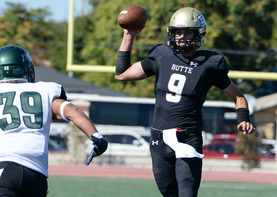 Butte quarterback Kyle Lindquist looks for an open receiver against Laney on Oct. 5 at Harrison Stadium in Oroville. (Matt Bates -- Enterprise-Record File)