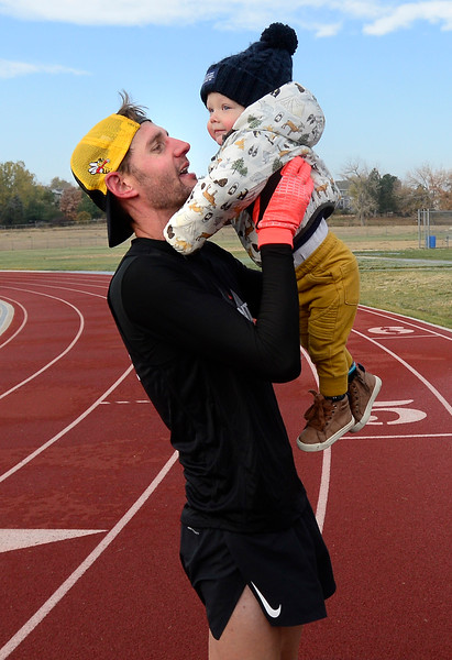 Guinness World Record for fastest mile run while pushing a stroller