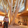 """Tour of the Groton Hill Music Center, under construction, where the Indian Hill Music will move. Lisa Fiorentino, CEO of Indian Hill Music, in the entrance lobby, which features what they're calling """"Octotree,"""" made of Southern yellow pine.   SUN/Julia Malakie"""