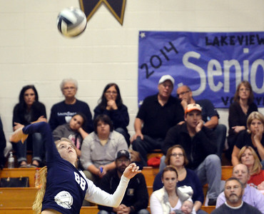WARREN DILLAWAY / Star Beacon PARADIE MADYSON of St. John leaps for a spike on Monday evening during Division IV district volleyball action at Lakeview.