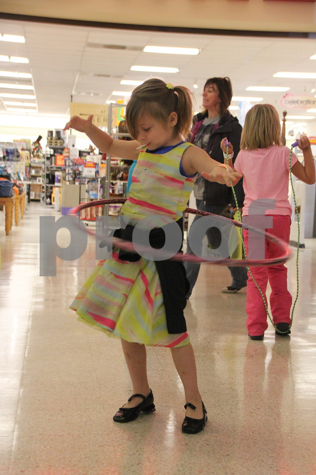 Pictured here with the hula hoop is Braylee Dutcher. On Saturday, October 24, 2015, Crossroads Mall in Fort Dodge held the Kidzmania event. The Mall was filled with  vendors of every kind offering  opportunities to learn lots of things,  have  some candy, and play games.