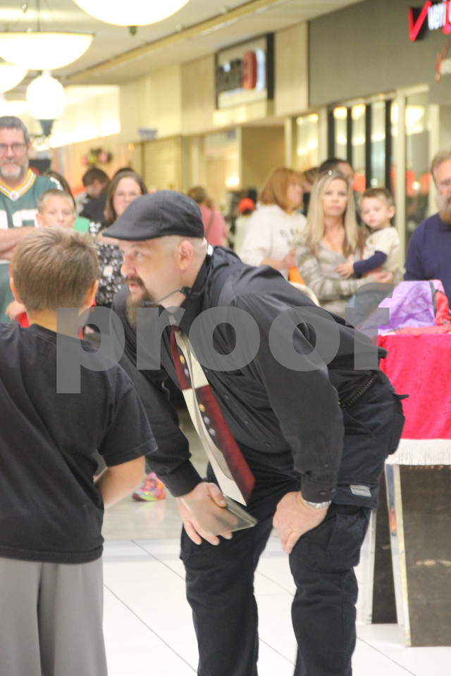 On Saturday, October 24, 2015, Crossroads Mall in Fort Dodge held the Kidzmania event.  The Mall was filled with vendors of every kind offering opportunities to learn lots of things, have some candy, and play games. Pictured here (on the  right) is Mike Mericle, one of  the magic acts appearing at center stage in the Mall.