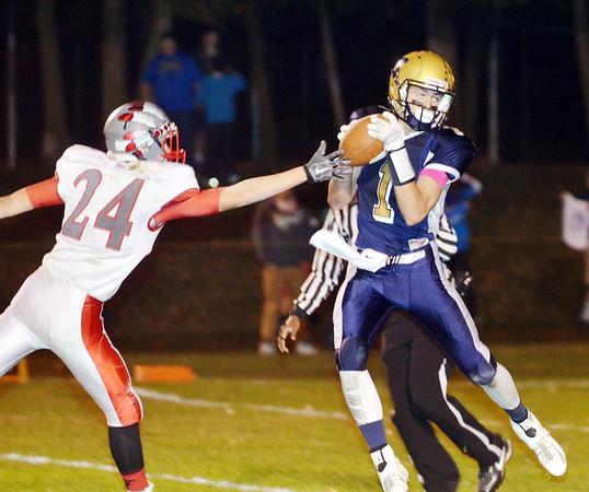 WARREN DILLAWAY / Star Beacon ALEX GERDES of Conneaut (1) catches a touchdown pass in front of Andrew Estock (24) of Edgewood on Friday night at Joslin Field in Conneaut.