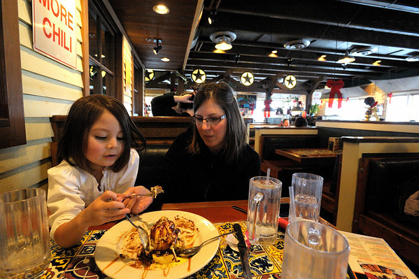 12/19/09 At Chili's with Madeline and Mommy