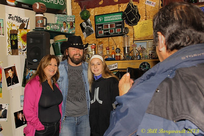 Jason McCoy posed for photos and signed autographs after the House Concert