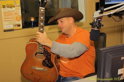 Gord Bamford at CFWE signing their special artist guitar.