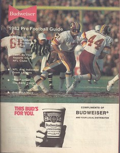 1983 Budweiser Pro Football Guide. Joe Theismann and John Riggins