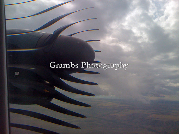 Outside the Airplane Window: an iPhone camera somehow turned the whirling blades of a turboprop into a sculptural object in the skies over Wyoming.