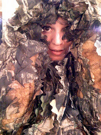 Leaves with eyes.  Trying on a ghillie suit at L.L. Bean's hunting & fishing store in Freeport, Maine.  Taken with an iPhone.