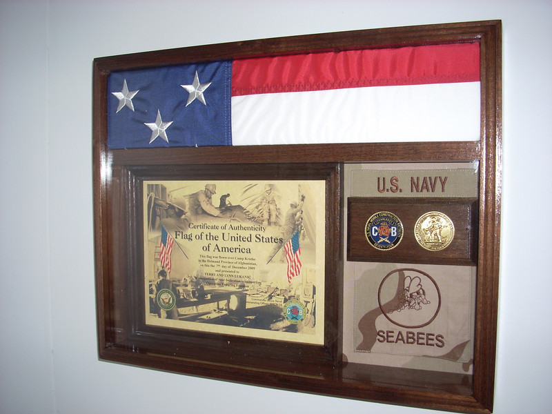 A special flag flown on a special day<br /> <br /> Flown on 07 December 2009 over Camp Krutke, Afghanistan<br /> <br /> Thanks to EA1 Dru Arana for the gift of the flag