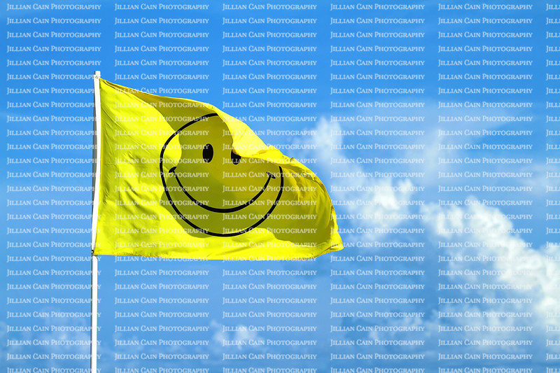Winking smiley face flag blowing in the wind