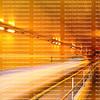 Blur of a car speeding through a tunnel