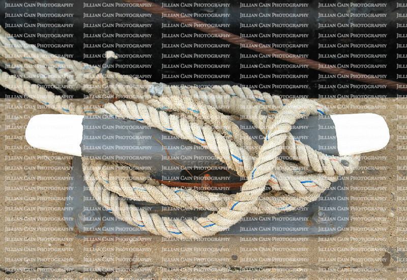 dock lines laid around a cleat at a boat yard