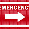 EMERGENCY sign and arrow in white pointing to the right against a red background.