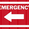 EMERGENCY sign and arrow in white pointing to the left against a red background.