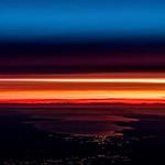 Plane Window View as the sun rises.