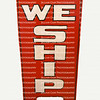 Isolated WE SHIP standing sidewalk sign