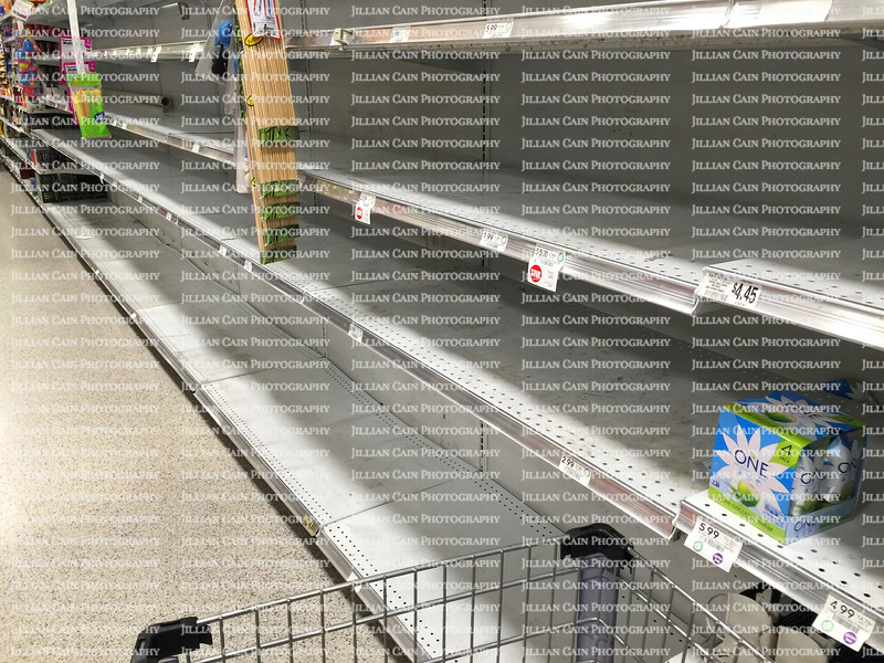 Supermarket aisle of bottled water is sold out prior to Hurricane Matthew