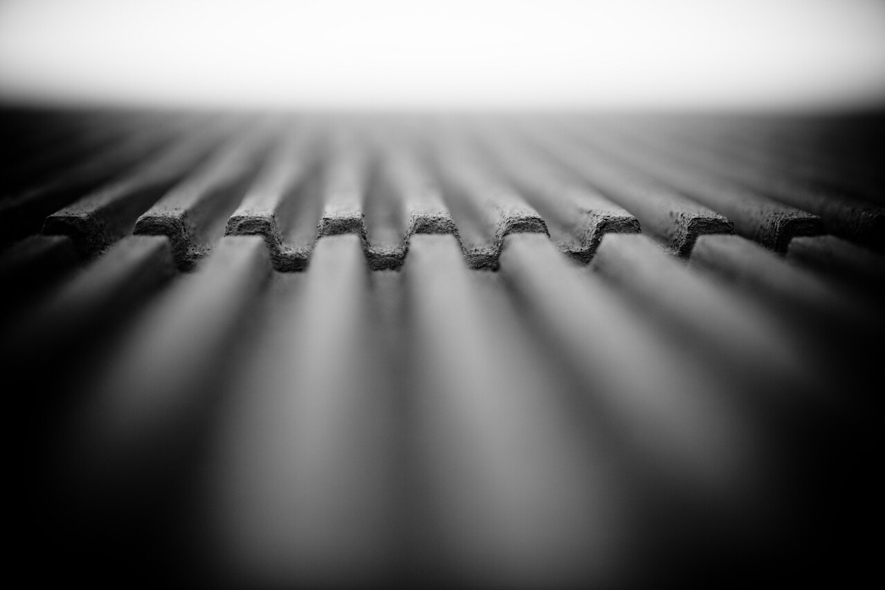 Stare at it long enough and see if you can figure out what it is.    Its actually the side of a building.  I put the camera right up against the building and shot it facing up.  It took a few tries to get the DOF I wanted but I think its a neat effect and hard to determine what it is easily.