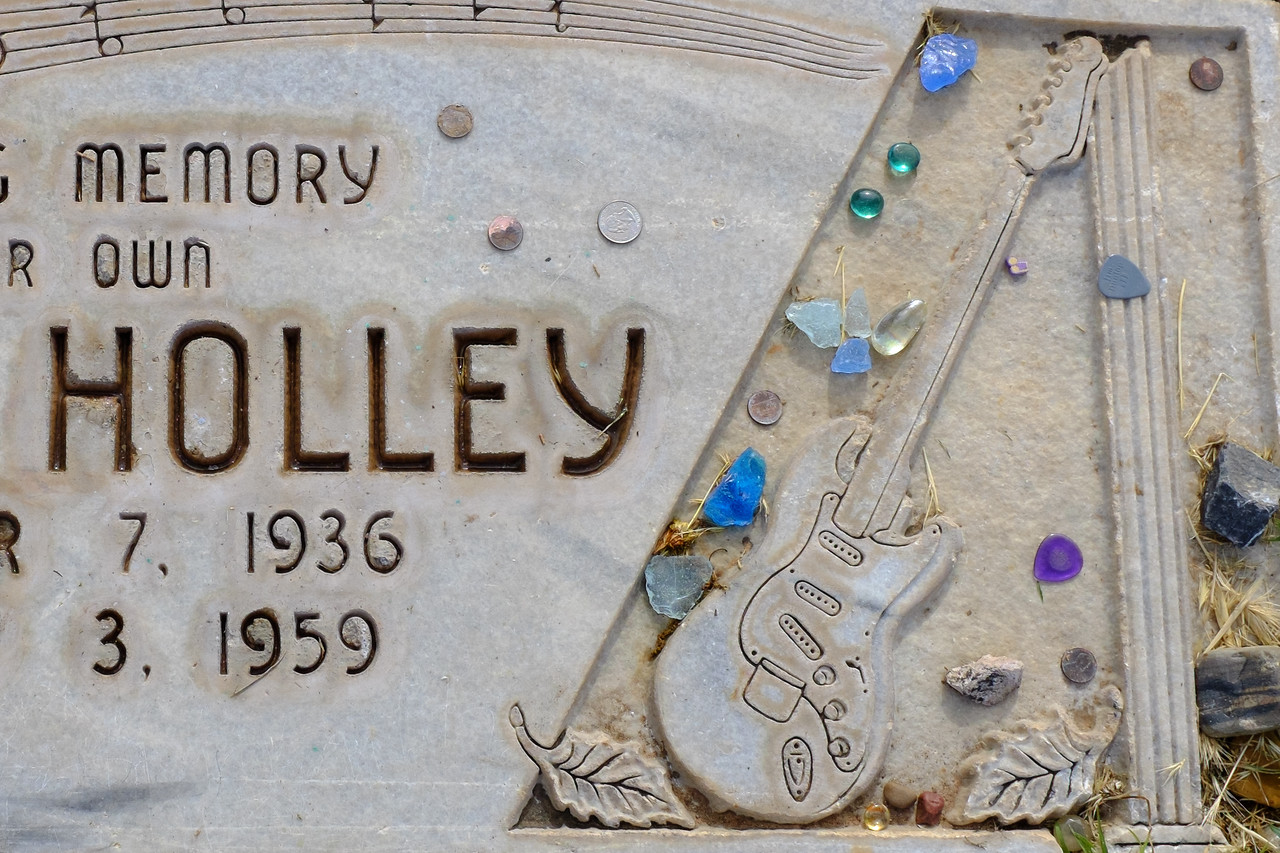 Buddy Holley tombstone, Lubbock, Texas. Note guitar picks on the right.