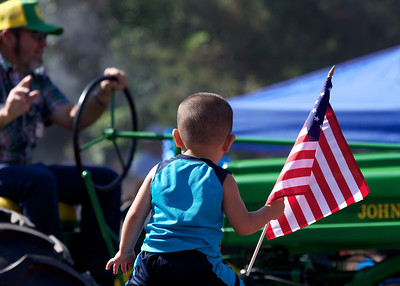 Fourth of July Parade, Lubbock, Texas 2013.The background is an antique John Deere tractor.