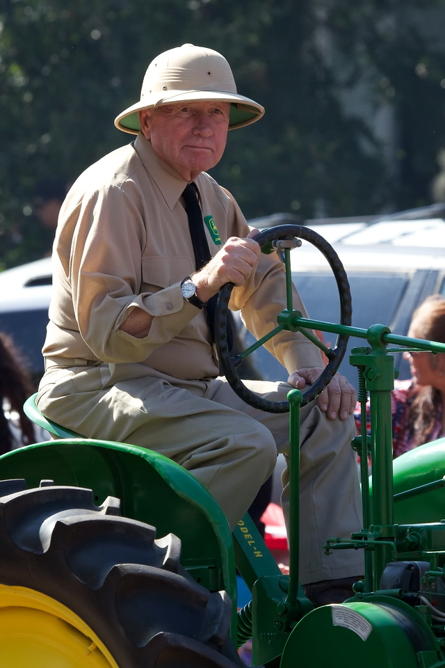 Fourth of July Parade, Lubbock, Texas 2013. I don't know this gentleman on the antique tractor, but he is wearing the clothing of an agricultural researcher in 1955; pith helmet, khaki shirt and tie.