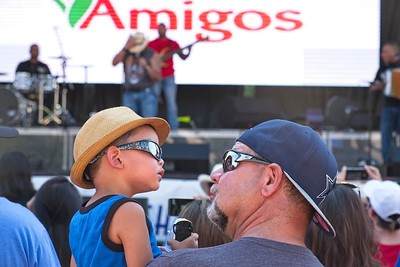 Father and son watching the entertainment at the Lubbock 4th of July festival, 2017.