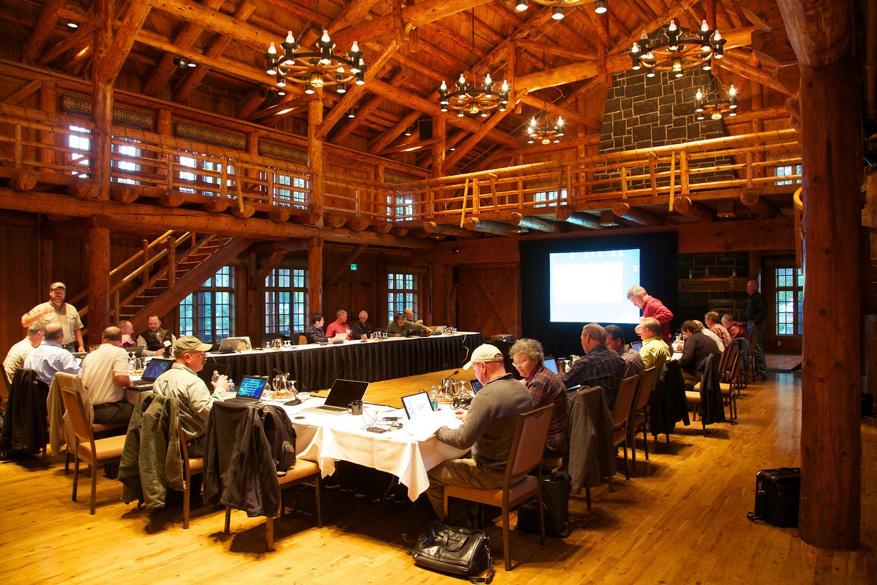 The people are southeastern U.S. entomologists and the structure is the Great Hall at the Sunriver Resort in Oregon. This magnificent building was built during WWII of old growth pine.
