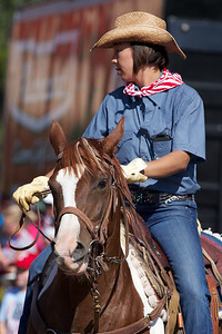 Fourth of July Parade, Lubbock, Texas 2013. This woman is part of the Forgotten West Riders, a group that graces our 4th of July parade. A photo of her last year is also in this gallery.