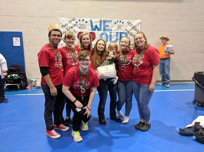Williamsport Area High School, Division 3, Problem 3, Classics: From back left is Quahme Powell, Hailey Kinley, Charlotte DeBloois, Coach Spring Moore, Daisy LeBlanc, Madison Williamson. At front is Alexandria Hopkins.