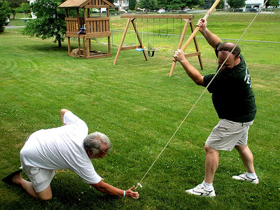 Barry and Bryan hard at work putting up the party tent anticipating the forecast thunderstorms that were supposed to roll through Upper Macungie.  I guarantee this is the first and last time you'll ever see Barry on his knees...