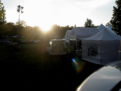 The sun settles over the vendor tents...