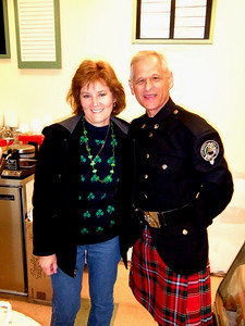 Something's out of kilter here.  Sharon's wearing pants and the Celtic Spirit bandmember is wearing a skirt...okay kilt, feel better?  So Sharon's out of Kilt-er while the bandmember is in Kilt-er.  Oh, that's bad!