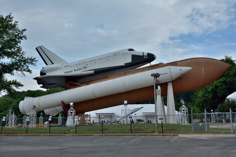 A fully-stacked Space Shuttle System (STS) with a  replica shuttle ' Pathfinder' , complete with solid rocket boosters, genuine space shuttle main engine nozzles and external tank. <br /> Dwarfed by the assembly is a T-38 jet used for astronaut training.<br /> <br /> U.S. Space & Rocket Center<br /> Huntsville.Alabama